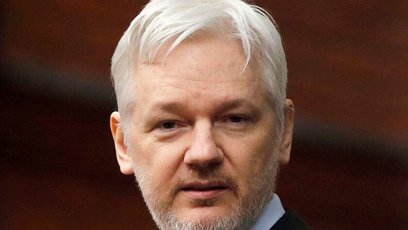 FILE - In this Feb. 5, 2016, file photo, WikiLeaks founder Julian Assange stands on the balcony of t
