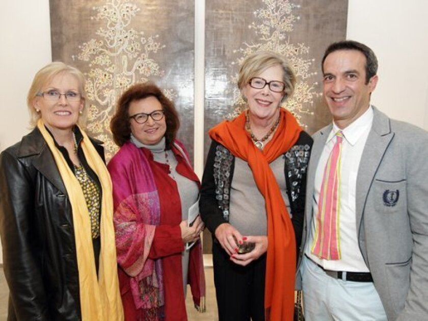 """Terre Frank, Laura Rafal, Libby Frank, guest artist Carlos Vega stand in front of """"Ivory Tower"""""""