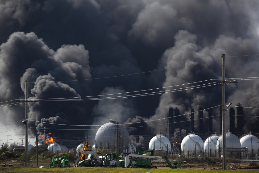 Smoke from an explosion at the TPC Group plant billows upward Wednesday in Port Neches, Texas.