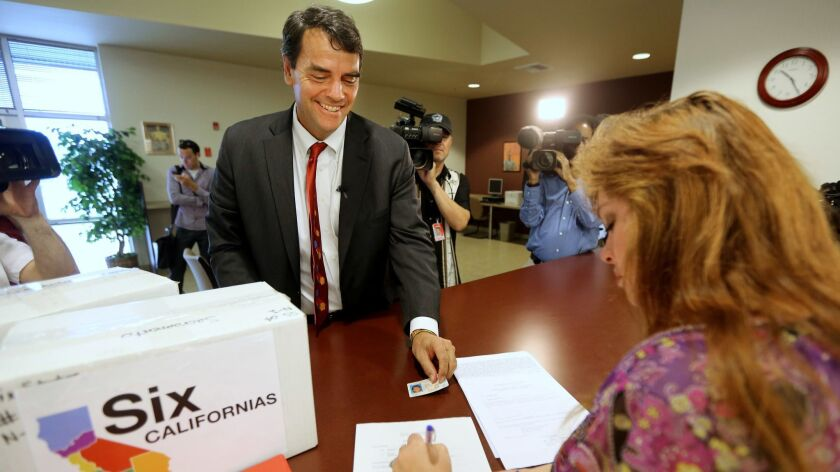 Silicon Valley venture capitalist Tim Draper in 2014, when he turned in boxes of petitions for a ballot initiative that would ask voters to split California into six states. The initiative did not qualify, and now he's back with a new plan to break California into three states.