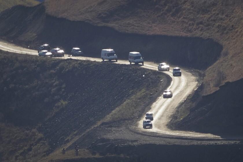 Motorists leaving the separatist region of Nagorno-Karabakh approach the border of Armenia on Sunday.