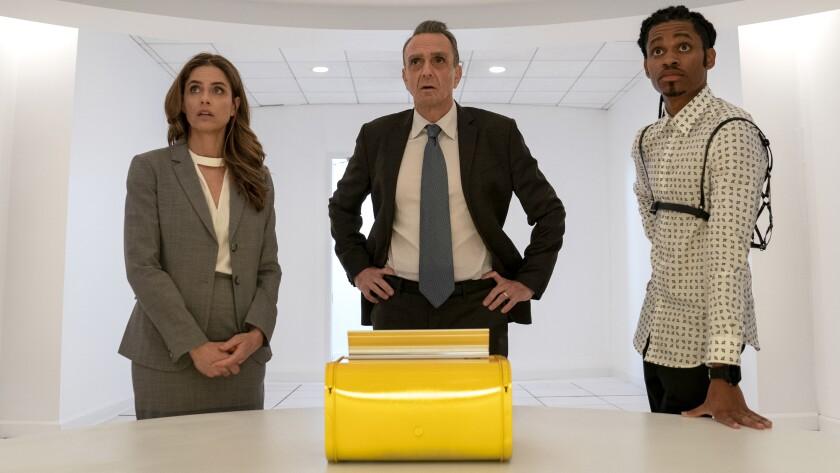 "Amanda Peet, left, Hank Azaria and Tyrel Jackson Williams in the series finale of the comedy ""Brockmire"" on IFC."