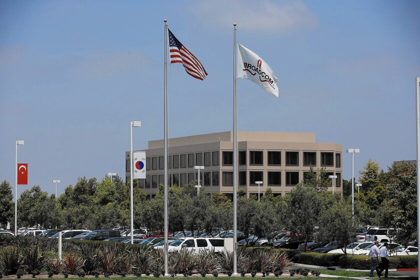 Broadcom, above, and Avago Technologies, which is buying the Irvine chip maker, projected cost savings of $750 million in the 18 months after the deal closes.