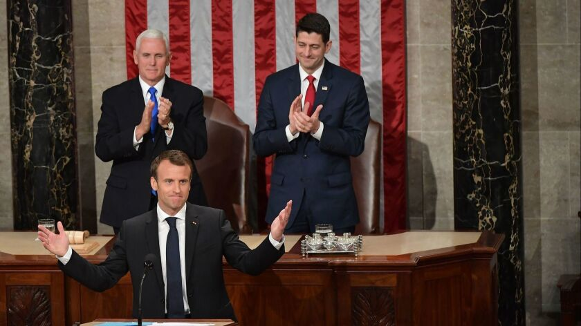 Vice President Mike Pence, rear left, and House Speaker Paul D. Ryan (R-Wis.), rear right, applaud after French President Emmanuel Macron addressed a joint meeting of Congress.