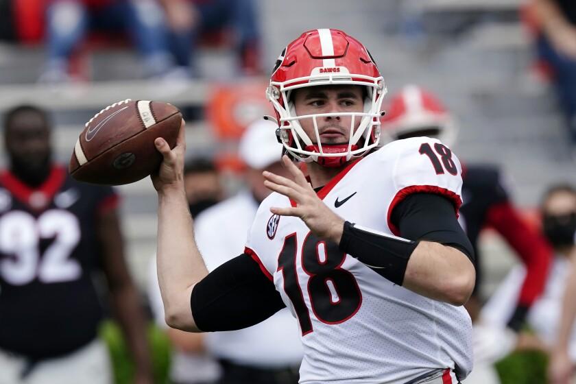 Georgia quarterback JT Daniels throws a pass.