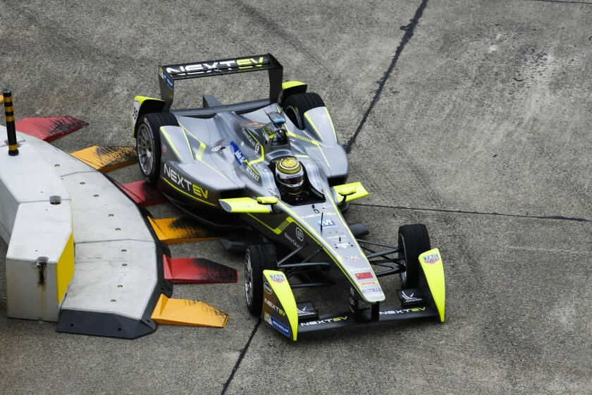 Nelson Piquet jr. from Bazil drives his car during a non-qualifying practice session at the Formula E Berlin ePrix auto race, in Berlin, Germany, Saturday, May 23, 2015. (AP Photo/Markus Schreiber)
