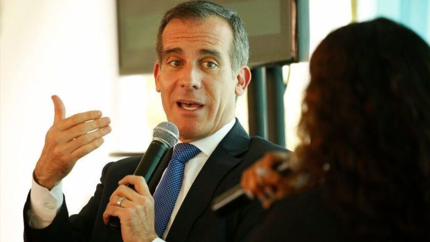 Los Angeles Mayor Eric Garcetti interviews Rhiana Gunn-Wright, leader of the nonprofit group New Consensus, just after Garcetti on Monday announced L.A.'s new sustainability plan, which he touted as the city's Green New Deal.