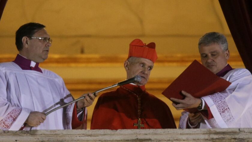 Cardinal Jean-Louis Tauran, center, announces the election of of Pope Francis from the central balcony of St. Peter's Basilica at the Vatican in 2013.