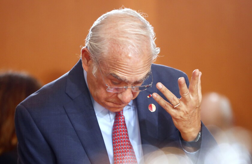 Organisation for Economic Co-operation and Development (OECD) Secretary General Angel Gurria gestures during a meeting of German Chancellor Angela Merkel with leaders of international economic and financial organizations at the Chancellery in Berlin, Germany, Tuesday, Oct. 1, 2019. (Hannibal Hanschke/Pool via AP)
