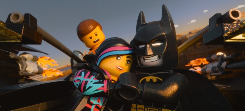 """Emmet voiced by Chris Pratt, Wyldstyle voiced by Elizabeth Banks and Batman voiced by Will Arnett, in a scene from """"The Lego Movie."""""""