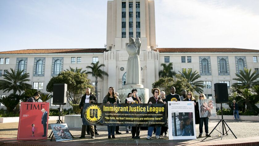 Representatives from the Immigrant Justice League hold a press conference outside the County Administration Center in San Diego, California.