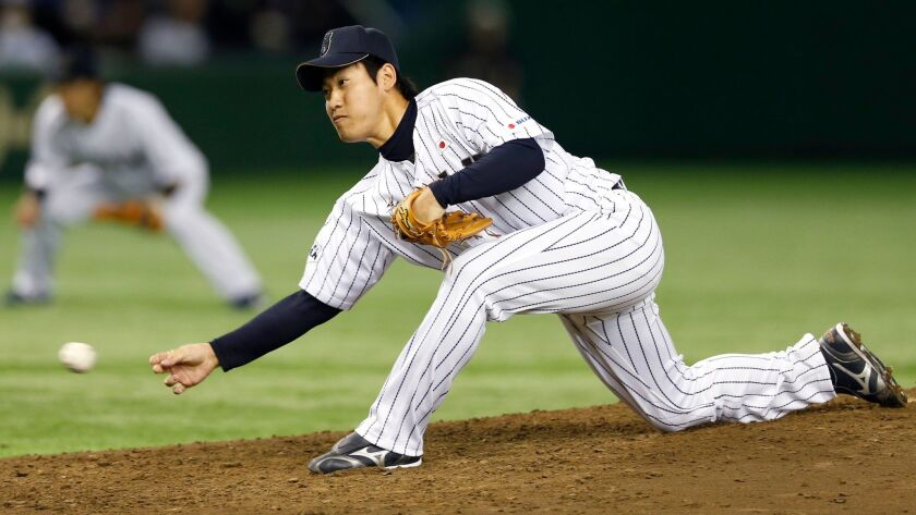Team Japan's Kazuhisa Makita pitches against Team Europe in the fourth inning of their friendly baseball game at Tokyo Dome in Tokyo, Tuesday, March 10, 2015.