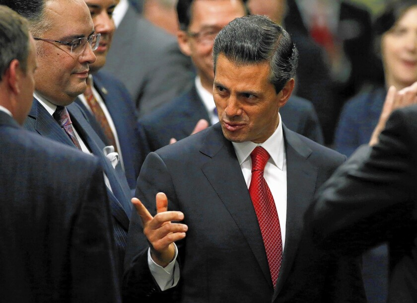 Mexico's President Enrique Peña Nieto greets California lawmakers before delivering his address to a joint session of the Legislature at the Capitol in Sacramento.