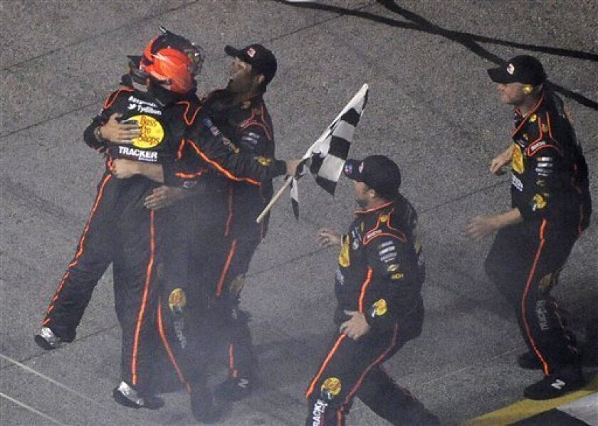 Camping World Truck Series driver Ty Dillon, left, celebrates with his team after winningthe Grit Chips 200 truck race at Atlanta Motor Speedway, Friday, Aug. 31, 2012, in Hampton, Ga. (AP Photo/David Tulis)