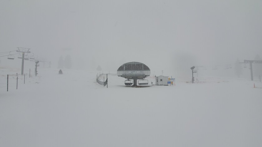 Snow falling Wednesday morning at Snow Valley Mountain Resort in Running Springs, Calif.