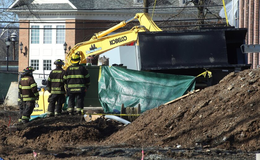 Police, firefighters and rescue workers work the scene of a construction accident involving a crane and a fallen generator at the future home of the Whippany Fire Company in Hanover, N.J., Thursday, Feb. 18, 2016. A five-ton generator fell from a crane at the construction site in northern New Jerse