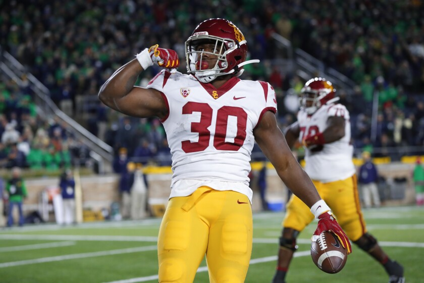 USC running back Markese Stepp flexes his bicep after scoring on a 2-yard touchdown run in the second half against Notre Dame in South Bend, Ind. on Saturday.