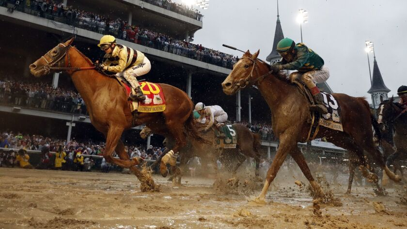 Flavien Prat rides Country House to the finish line during the 145th running of the Kentucky Derby h