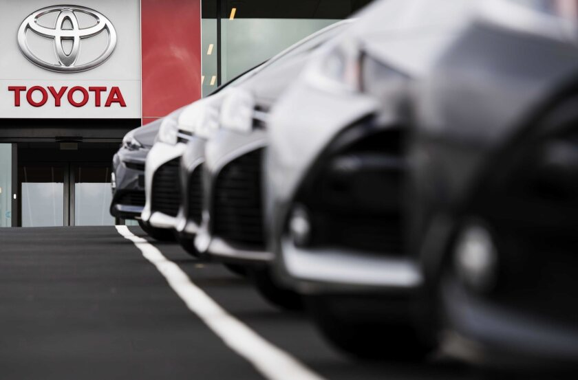 Toyota vehicles are parked at a dealership at the Hague.