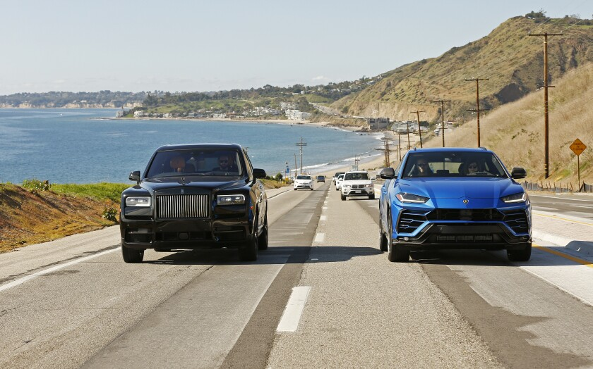 MALIBU, CA - JANUARY 21, 2020 The Lamborghini Urus in blue and the Rolls-Royce Cullinan in black are photographed in Malibu for a comparison with the rise of the UUV (ultra utility vehicle). The stars are the Lamborghini Urus and the Rolls-Royce Cullinan with a two-fold vibe; elegant and urban; and sandy/beachy/off-road.(Al Seib / Los Angeles Times)