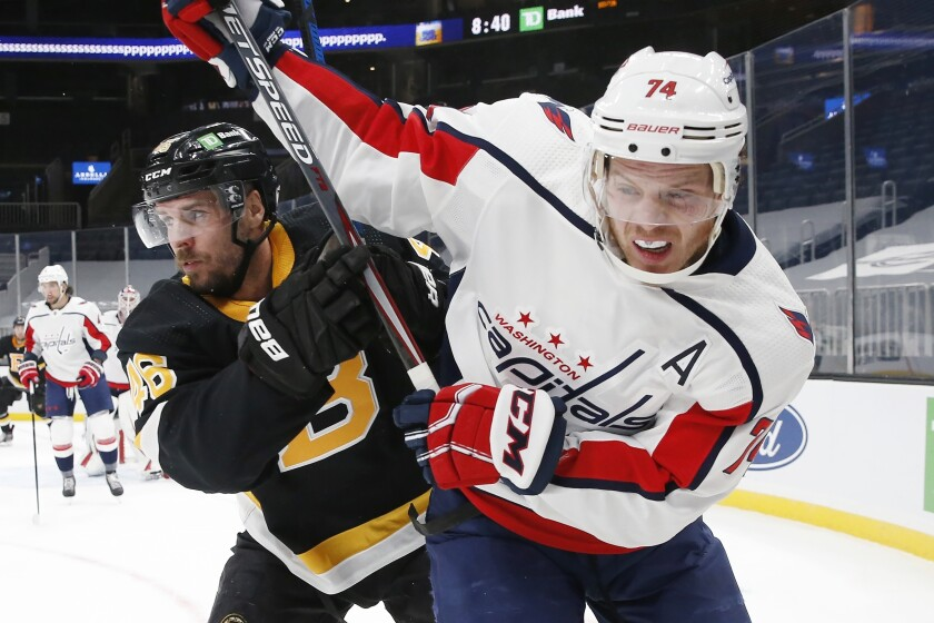 Washington Capitals' John Carlson (74) defends against Boston Bruins' David Krejci (46) during the second period of an NHL hockey game Friday, March 5, 2021, in Boston. (AP Photo/Michael Dwyer)