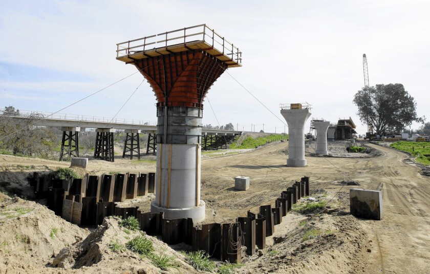 The supports for a 1,600-foot viaduct to carry high-speed trains across the Fresno River are seen under construction near Madera, Calif.