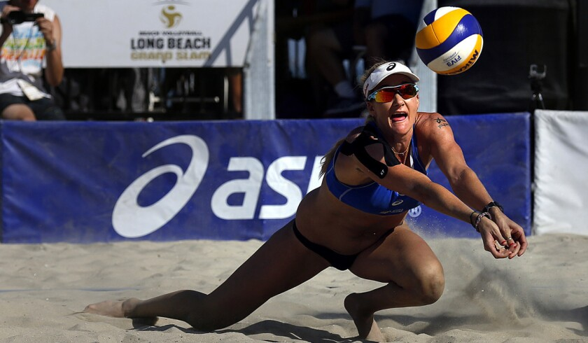 Kerri Walsh Jennings makes a dig during a match against Italy at the ASICS World Series Of Beach Volleyball.