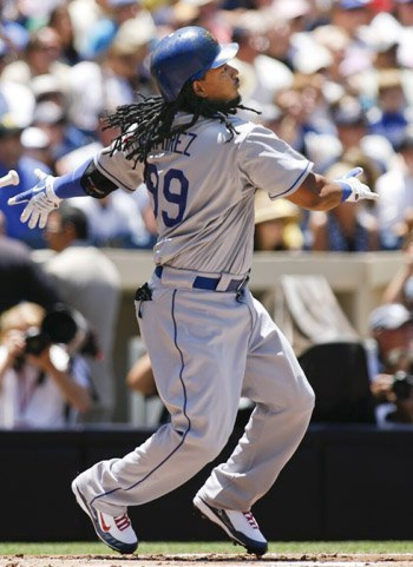 Los Angeles Dodgers' Manny Ramirez watches the flight of a solo home run hit off of San Diego Padres pitcher Josh Geer during the first inning.
