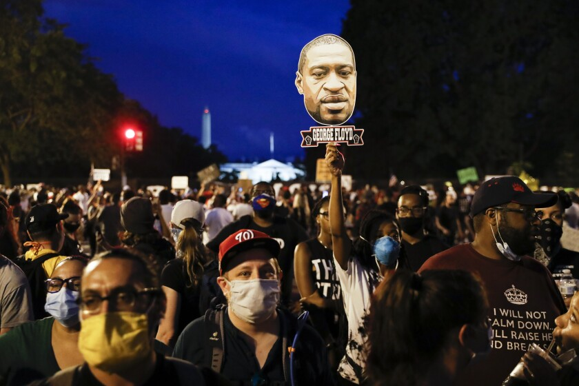 Demonstrators protest Saturday, June 6, 2020, near the White House in Washington, over the death of George Floyd, a black man who was in police custody in Minneapolis. Floyd died after being restrained by Minneapolis police officers. (AP Photo/Jacquelyn Martin)