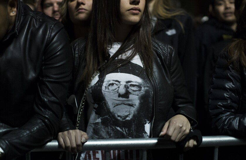 Supporters of Democratic presidential candidate Bernie Sanders rally Wednesday in New York's Washington Square Park.