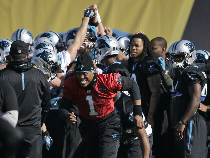Carolina Panthers quarterback Cam Newton (1) runs to his station after huddling with teammates during practice in preparation for the Super Bowl 50 football game Friday Feb. 5, 2016 in San Jose, Calif. (AP Photo/Marcio Jose Sanchez)