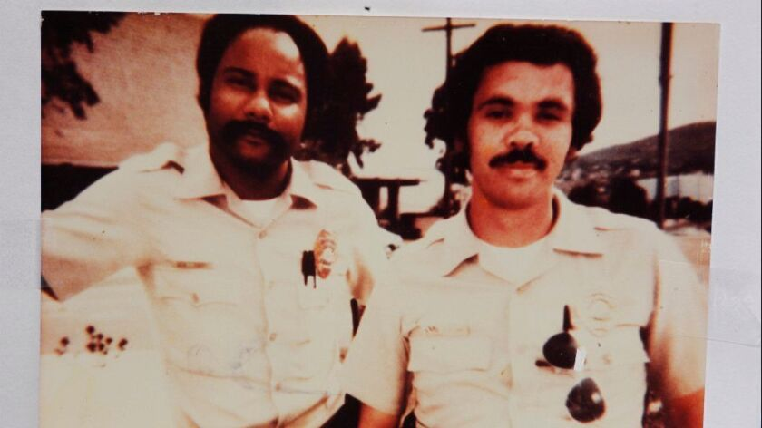 San Diego police Officer Archie Buggs, left, is shown with his partner, Jesse Navarro, a former police officer and now aide in the District Attorney's Office. Buggs was fatally shot in 1978.
