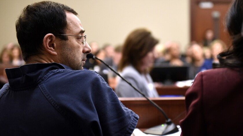 Larry Nassar sits in court during a sentencing hearing Thursday, Jan. 18, 2018, waiting for the thir
