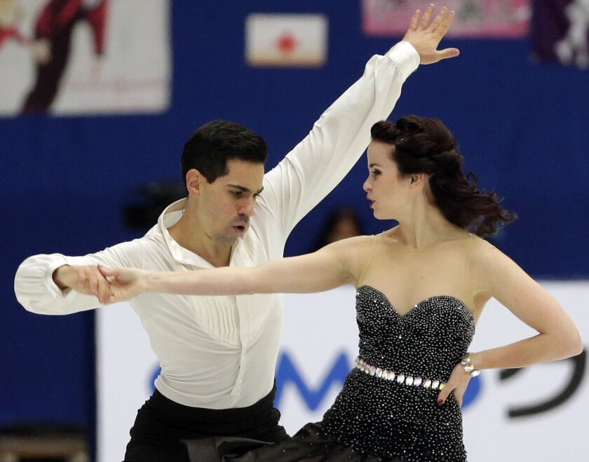 Italy's Luca Lanotte, left, and Anna Cappellini, right, compete in the Ice Dance Free Dance program during the ISU Grand Prix of Figure Skating at the Capital Gymnasium in Beijing, China, Saturday, Nov. 7, 2015. (AP Photo/Mark Schiefelbein)