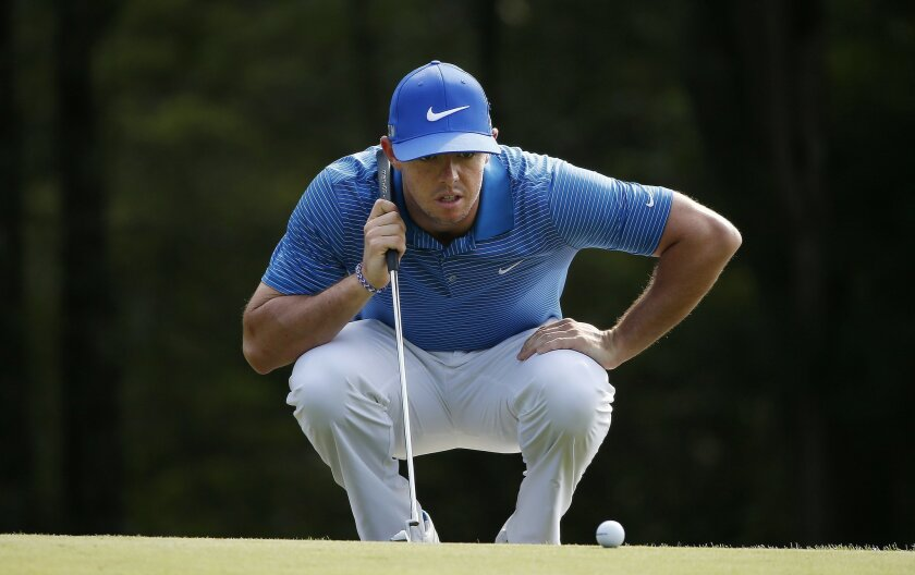 Rory McIlroy lines up a putt on the 18th hole during the third round of the Deutsche Bank Championship golf tournament in Norton, Mass., Sunday, Aug. 31, 2014. (AP Photo/Michael Dwyer)