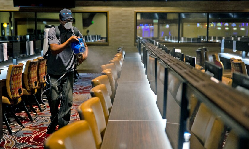 A Sycuan casino employee disinfects the interior of the casino. The casino is one several in San Diego that are planning to reopen. (Courtesy of the Sycuan Casino)