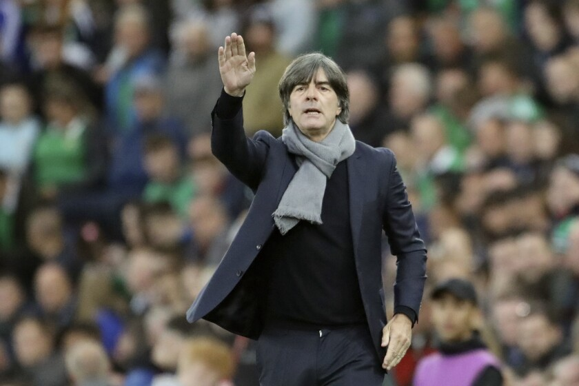 Germany coach Joachim Loew gestures during the Euro 2020 group C qualifying soccer match between Northern Ireland and Germany at Windsor Park, Belfast, Northern Ireland, Monday, Sept. 9, 2019. (AP Photo/Peter Morrison)