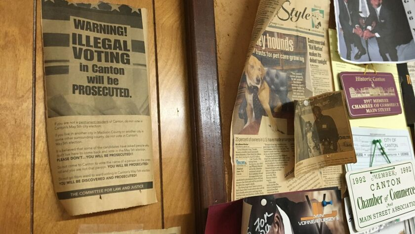 An old newspaper ad taped to the wall at the office of WMGO-AM 1370 in Canton, Miss., warns against illegal voting,