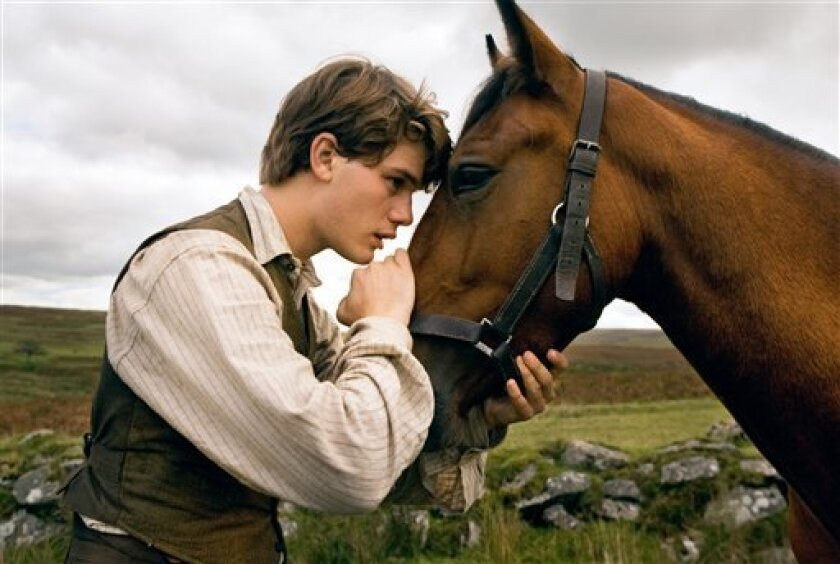 """In this film image released by Disney, Jeremy Irvine is shown in a scene from """"War Horse."""" Producers Kathleen Kennedy and Steven Spielberg were nominated for nominated Tuesday, Jan. 3, 2012, for the 23rd Annual Producers Guild Awards for the film """"War Horse."""" The winners will be announced on Jan. 21. (AP Photo/Disney, Andrew Cooper)"""