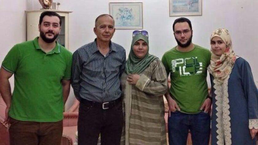 The Tarakji family: son Yaman Tarakii, 27; father, Manaf Tarakji, 58; mother, Alshifaa Hammoush, 52; son Yasser Tarakii, 29; and daughter Maria Tarakji, 21. The father, mother and daughter arrived in the U.S. in April as Syrian refugees. Two sons are still in Saudi Arabia