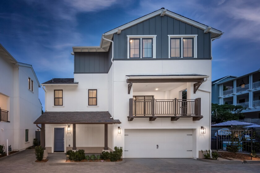 A single-family model home is now open in Carlyle Carlsbad Village's new enclave of townhomes and detached homes.