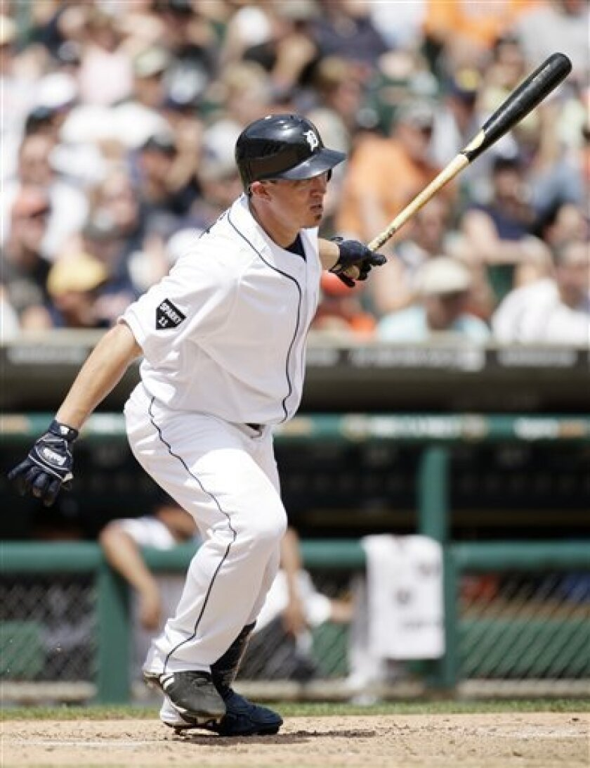 Detroit Tigers' Magglio Ordonez hits a two-run single in the seventh inning to drive in Brandon Inge and Jhonny Peralta and take a 4-3 lead over the San Francisco Giants in an interleague baseball game, Sunday, July 3, 2011 in Detroit. The Tigers defeated the Giants 6-3. (AP Photo/Duane Burleson)