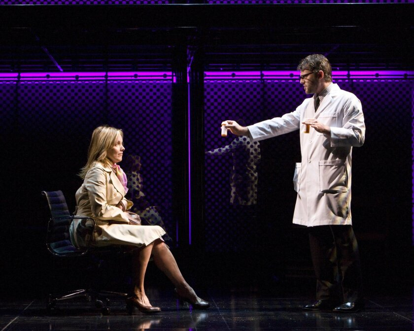 """The troubled Diana (Alice Ripley) ponders the latest treatment from her doctor (Jeremy Kushnier) in the 2011 touring version of the musical """"Next to Normal."""""""