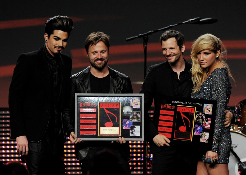 """Lukasz """"Dr. Luke"""" Gottwald and Kesha are shown onstage at the ASCAP Pop Music Awards in Los Angeles in 2011."""