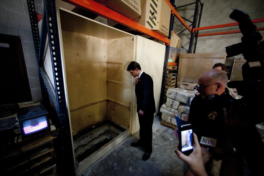 At a business warehouse in Otay Mesa, John Morton, director of U.S. Immigration and Customs Enforcement, stands near the tunnel entrance that was housed inside a large cabinet. Law enforcement discovered 10 tons of marijuana in a tractor trailer outside the warehouse and between 10 and 15 tons insi