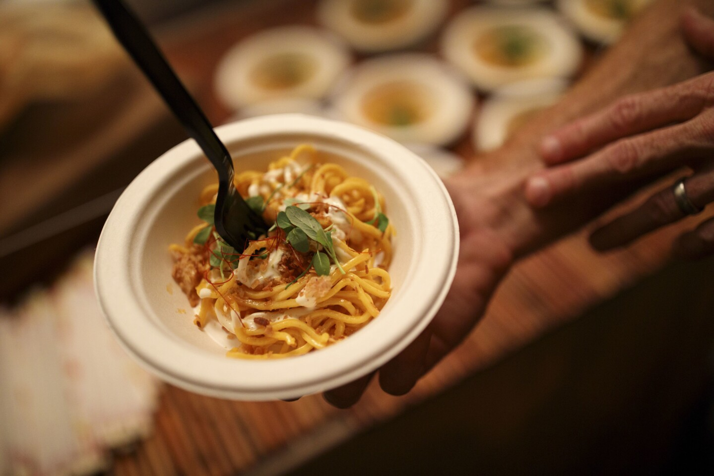 "Bourbon Steak serves Palabok noodles, made with egg noodles, crab butter, ""XO"" crumble, Yuzu aioli, chili herbs and chicharron, at The Taste."