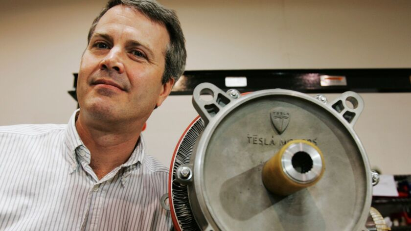 Martin Eberhard, a co-founder of Tesla Motors, poses next to an electric motor in 2006. Eberhard is chief innovation officer and chief scientist of SF Motors, a China-owned start-up that bought a former Humvee plant in Indiana.