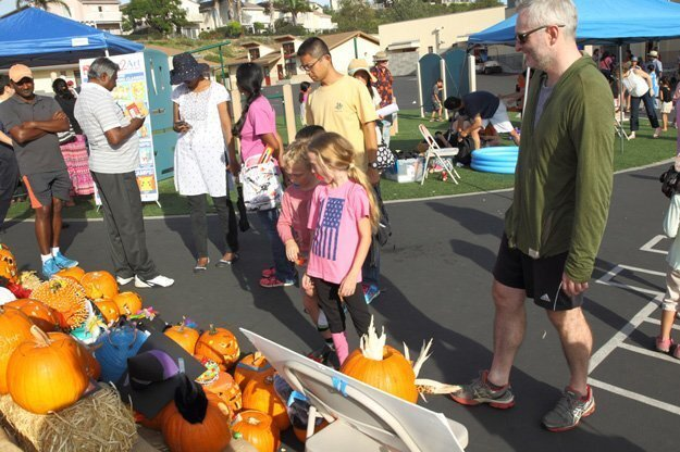 The Erb family looks at the pumpkin display
