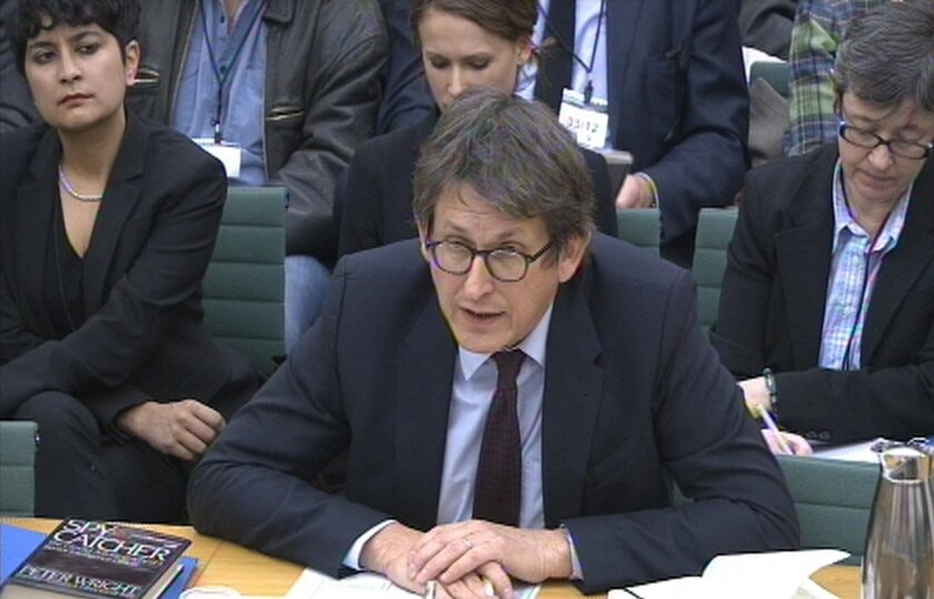 """Editor of The Guardian newspaper Alan Rusbridger gives evidence to the Commons Home Affairs Committee hearing on counter-terrorism at Portcullis House, central London, Tuesday, Dec. 3, 2013. Alan Rusbridger has been questioned by Parliament's home affairs committee as part of a session on counter-terrorism, following The Guardian's publishing of a series of stories based on Edward Snowden's leaks disclosing the scale of surveillance by spy agencies in the United States and Britain. The editor of The Guardian says his newspaper has published just 1 percent of the material it received from former National Security Agency contractor Snowden and """"made very selective judgments"""" about what to publish and had not revealed any intelligence staffers' names. He said: """"We have published no names and we have lost control of no names."""" Government and intelligence officials have said the leaks compromised British security and aided terrorists. (AP Photo/PA) UNITED KINGDOM OUT - NO SALES - NO ARCHIVES"""