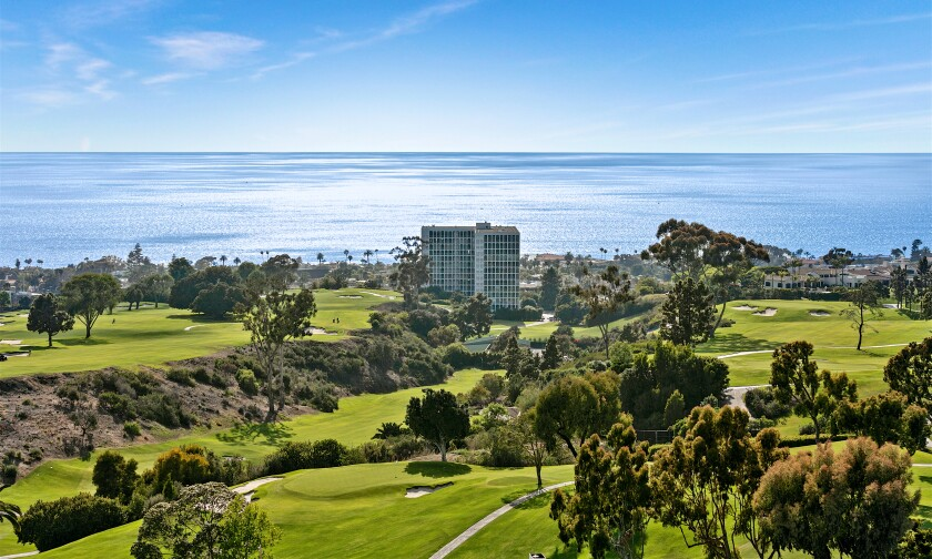 The scenic, swirling home takes in ocean and golf course views from three levels of living spaces.